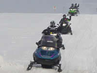 Snowmobilers on the trail