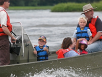 Adults and children boating safely