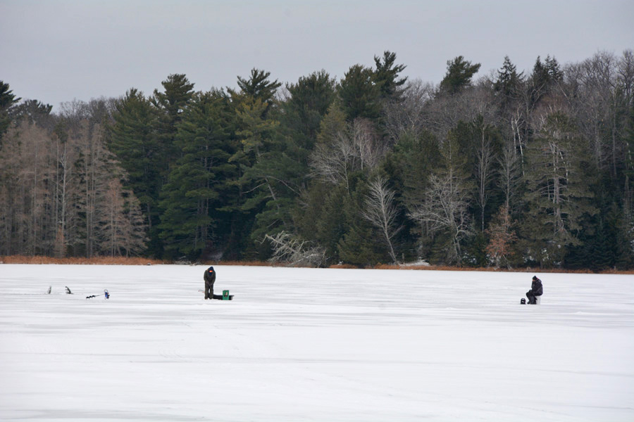 Ice anglers have begun to venture out on lakes in far northern Wisconsin, like these anglers fishing this week on Big Arbor Vitae. - Photo credit: DNR
