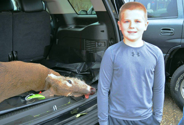 11-year old Shane Olson with his deer