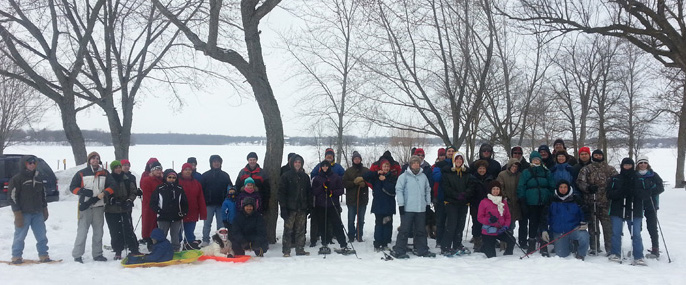 Hikers gather for a group photo at a 2014 First Day Hike at the Pike Lake Unit of the Kettle Moraine State Forest.