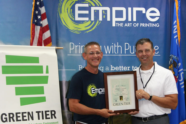 Dan Baumann (right)(Secretary's Director, WI Department of Natural Resources) formally welcomes Empire Screen Printing into Green Tier. John Freismuth (President, Empire Screen Printing) accepts the plaque.
