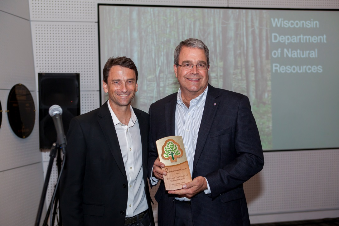 Forest Stewardship Council US President Corey Brinkema (left) presents the 2016 FSC Leadership Award to Mark Heyde, coordinator of forest certification programs at Wisconsin Department of Natural Resources.