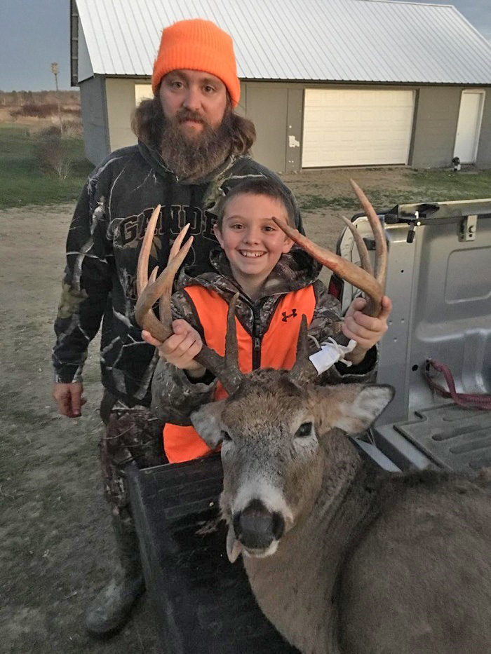A smile as wide as the spread! First gun-deer buck for Landon Wisnor in Monroe County