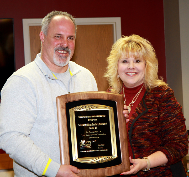 Mike Albert from the Town of Sullivan Laboratory receives the 2017 Lab of the Year Award from DNR Secretary Cathy Stepp.