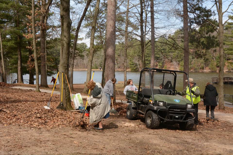 Volunteers clean up the boat launch picnic area at Mirror Lake State Park.