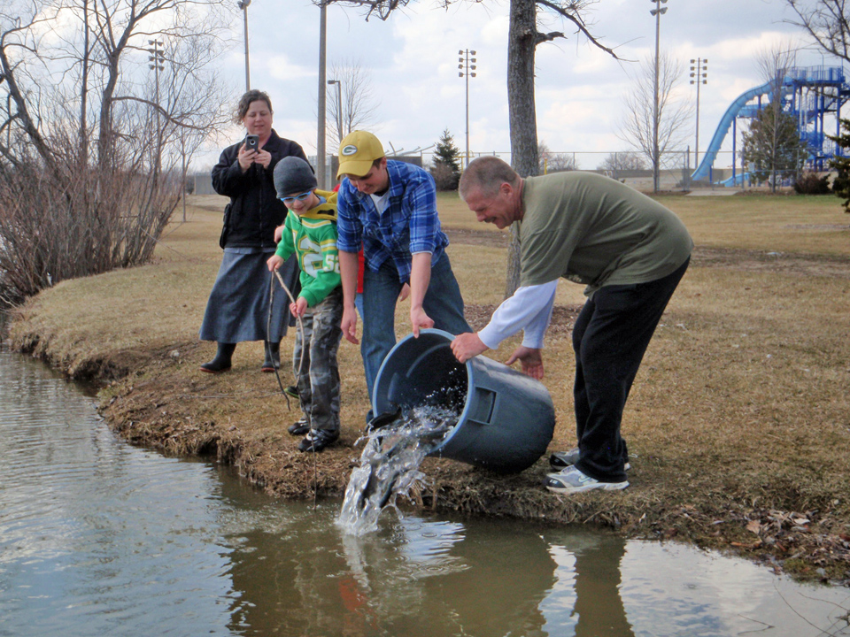 Stocking activities often draw appreciative attention as young anglers gear up for their special season on urban waters.