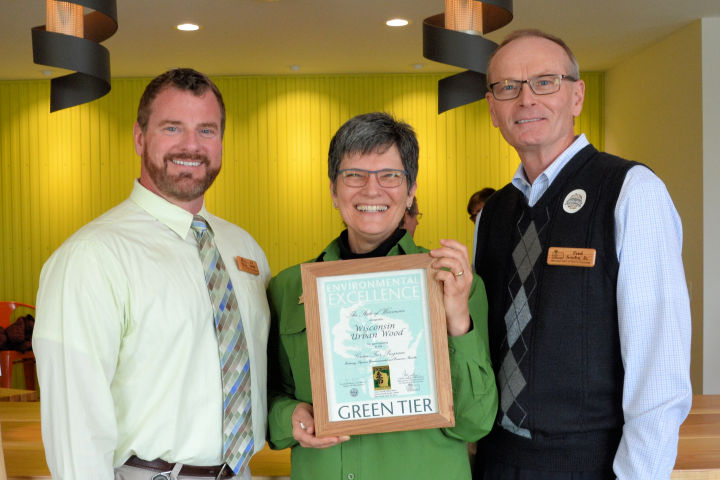 Secretary's Directory JD Smith (left) and State Forester Fred Souba Jr. (right) celebrate the signing of a Green Tier charter with Wisconsin Urban Wood's Executive Director Twink Jan-McMahon