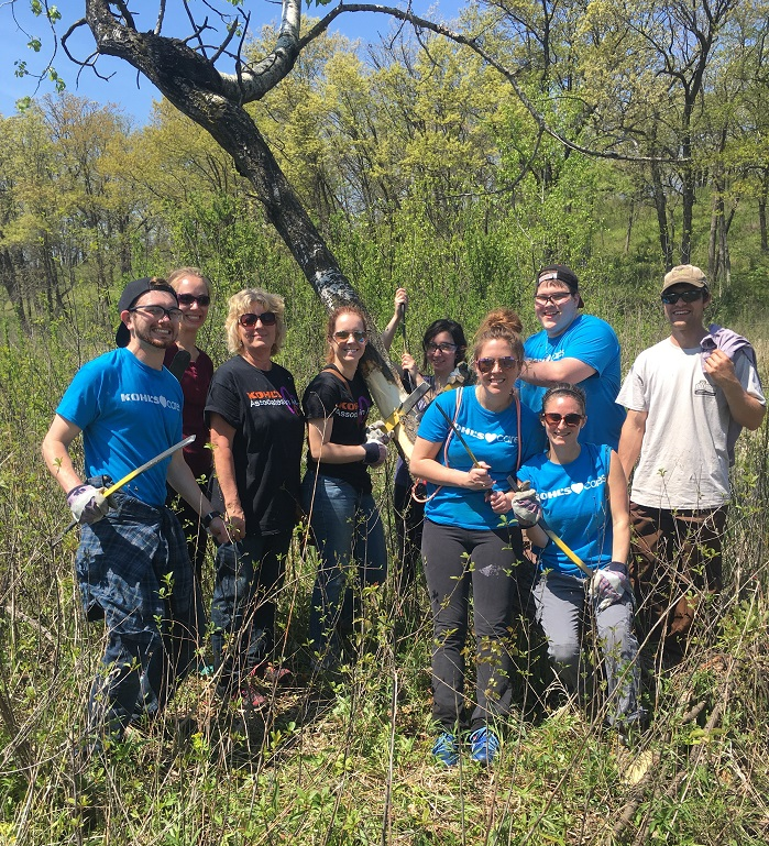 Volunteers at Genesee Oak Opening State Natural Area in Waukesha County helped gird aspen as part of efforts to restore the site to an open wetland with scattered oak trees.
