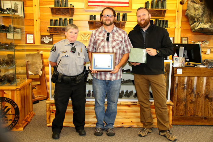 Left to right: Capt. April Dombrowski of the Bureau of Law Enforcement's Recreational Safety and Outdoor Skills Program, Winner Dan Burns of Madison, and corporate sponsor Vortex Optics' representatives Nick Laufenberg at a September 2 ceremony at the Vortex Optics Headquarters in Middleton.