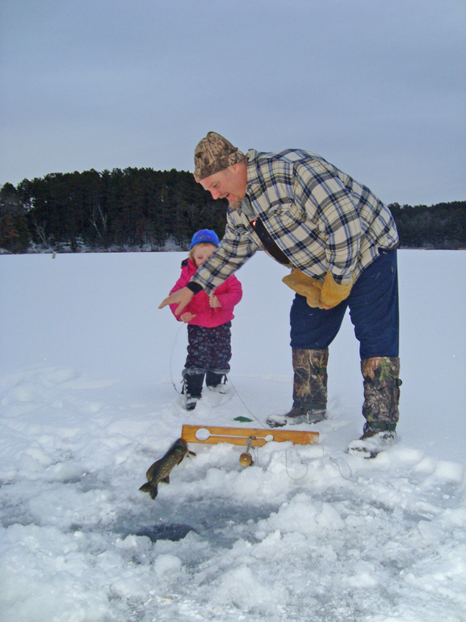 They caught on early! Scott Toshner helps daughter Corina handle a nice northern pike.  - Photo credit: DNR