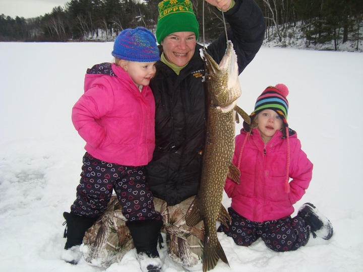Pamela Toshner and Scott Toshner started taking their daughters fishing when they were toddlers. - Photo credit: DNR