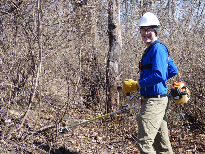 35 volunteer groups directly impacted 3,464 acres at 43 State Natural Areas in 2017, including helping cut and burn invasive brush like this volunteer does here.  - Photo credit: DNR
