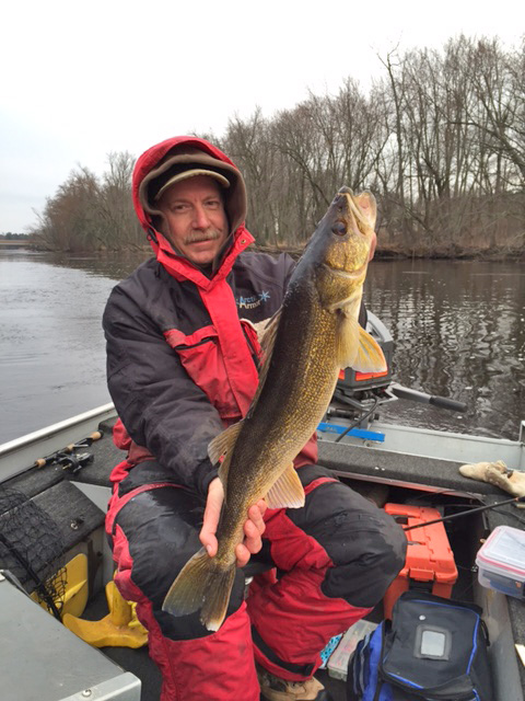 Steve Gilbert, a longtime fisheries manager and now a fisheries supervisor in northern Wisconsin, shares his walleye fishing tips. He displays a 27.9 inch walleye he caught on the Peshtigo River in  2016.  - Photo credit: DNR