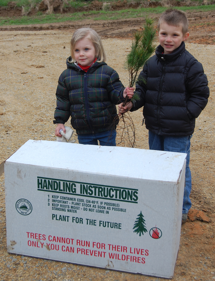 Tree planting is fun for forest stewards of all ages - especially on Arbor Day. - Photo credit: DNR