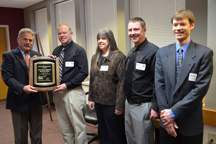 Brian Gollhardt of the Alliant Energy Edgewater Generating Station receives the 2018 Lab of the Year award from DNR Secretary Dan Meyer. Also pictured:  Paula Czekala, Chris Swoverland and Dave Galarowicz. Not pictured:  Keith DeBlaey who volunteered to stay back to keep the lab running. - Photo credit: DNR