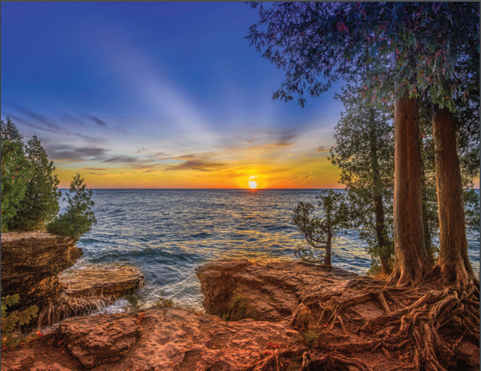 """Dawn at Cave Point""  - Photo credit: Michael Knapstein"