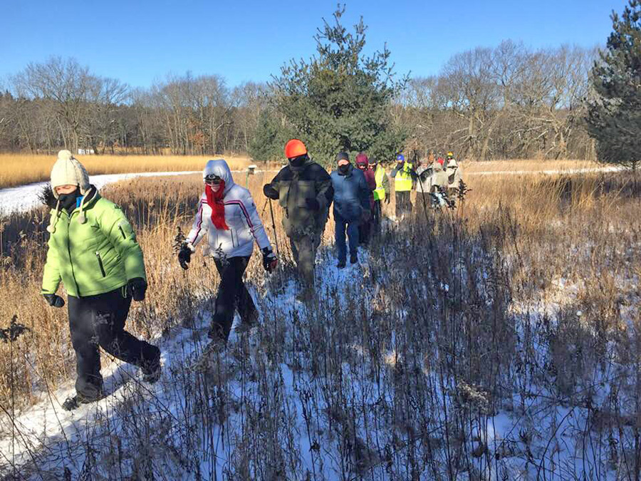 These hikers at the Lapham Peak Unit of the Kettle Moraine braved sub-zero temperatures and bitter windchills to participate in last year's First Day Hikes. - Photo credit: DNR