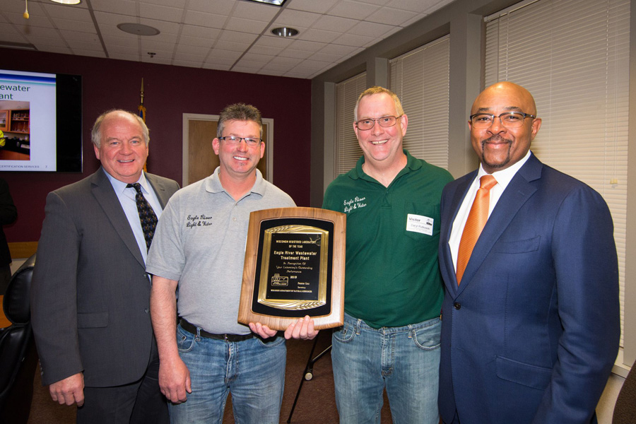 Daryl Rutkowski, right, and John Amorose, left, of the Eagle River Wastewater Treatment Plant receive the 2019 Lab of the Year award from DNR Secretary-Designee Preston Cole, right, and Natural Resources Board Chair Dr. Frederick Prehn, left.  - Photo credit: DNR