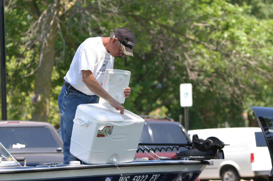 Draining live wells, bait buckets and bilges every time you leave a boat launch is a way for anglers to help keep waters healthy by stopping the spread of aquatic invasive species. - Photo credit: DNR