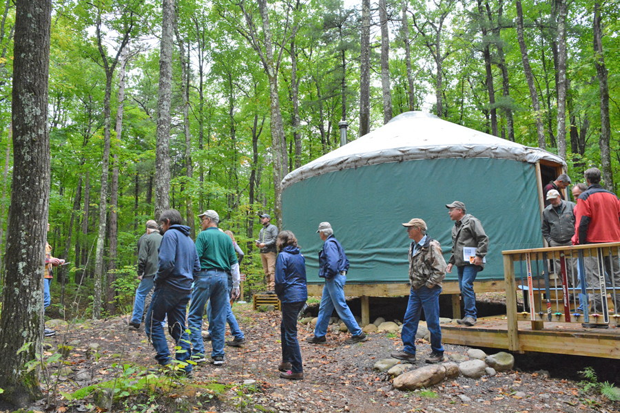 A camping yurt, similar to this one Wisconsin Natural Resources Board members toured last September in Bayfield County, would be allowed in the Flambeau River State Forest under a proposed master plan ammendment. - Photo credit: DNR