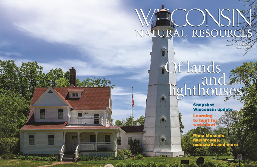 The cover of the fall issue features a wrap-around image of the Northpoint Lighthouse in Milwaukee. - Photo credit: DNR