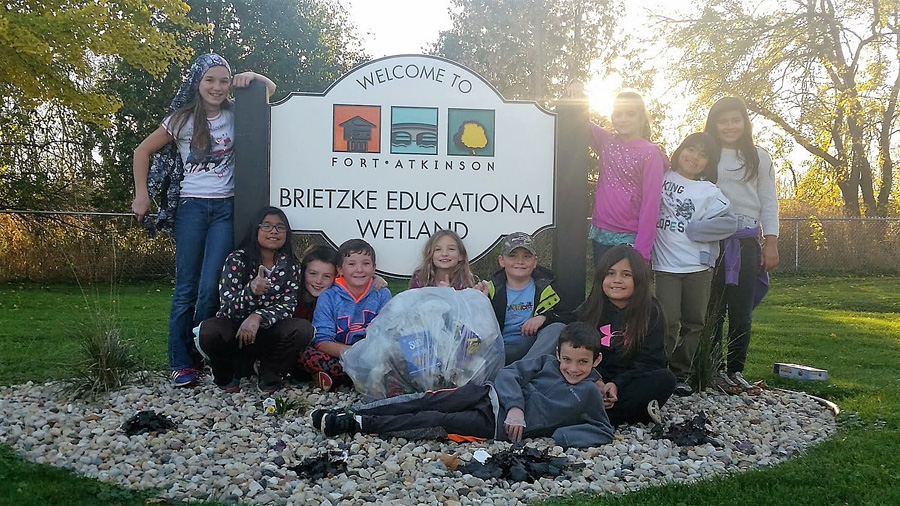 While caring for nearby Brietzke Educational Wetland, teachers and students from the Purdy Elementary School Green Team in Fort Atkinson recycle trash and compost organic materials.  - Photo credit: DNR