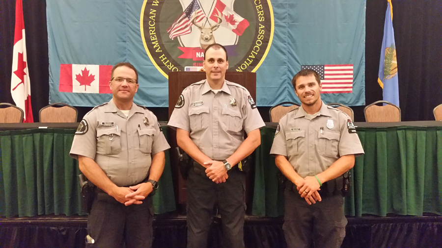 DNR Conservation Wardens Dave Youngquist of Iowa County, the Wisconsin representative to the North American Wildlife Enforcement Officers Association (NAWEOA), Dale Hochhausen named NAWEOA Officer of the Year (2019) and Kevin Christorf who was named winner of the NAWEOA's Region 5 Torch Award for 2019. - Photo credit: DNR