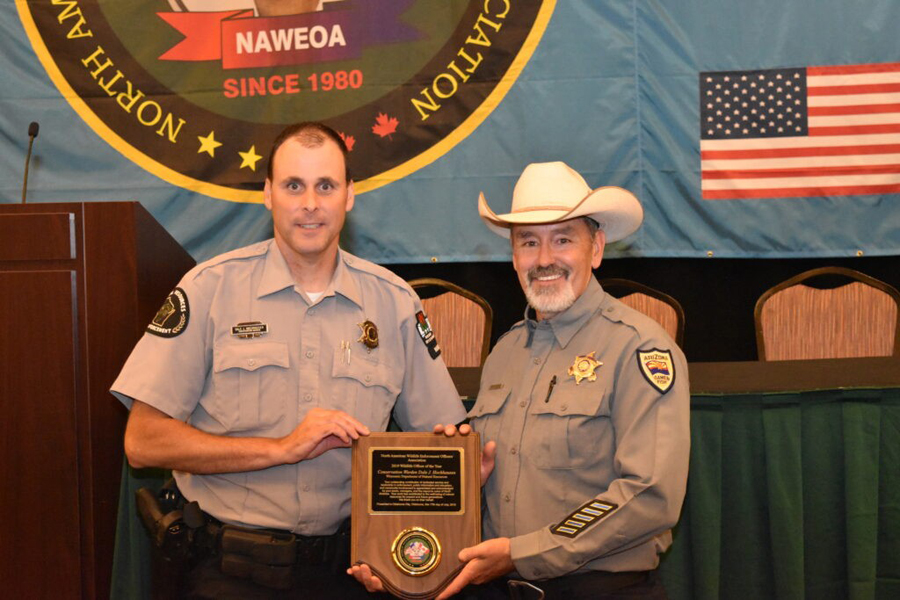 DNR Conservation Warden Dale Hochhausen of the Mississippi River Warden Team with Rick Langley of the North American Wildlife Enforcement Officers Association which named Hochhausen as the association's officer of 2019. - Photo credit: DNR