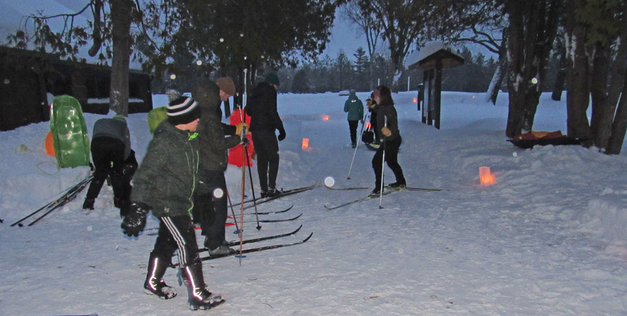 A candlelight ski and snowshoe hike is a highlight of Winterfest at Pattison State Park. - Photo credit: DNR