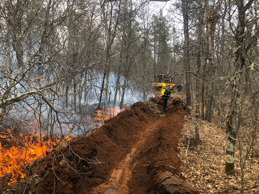 DNR fire crews work to fight a 4-acre fire in Burnett County on May 9. - Photo credit: DNR