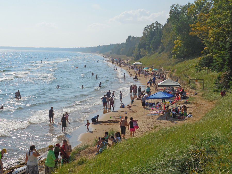 Unseasonably warm temperatures Saturday, Sept. 23 brought out the crowds to Whitefish Dunes State Park.