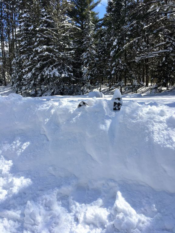 Snow and howling winds have created some impressive snow drifts. - Photo credit: DNR