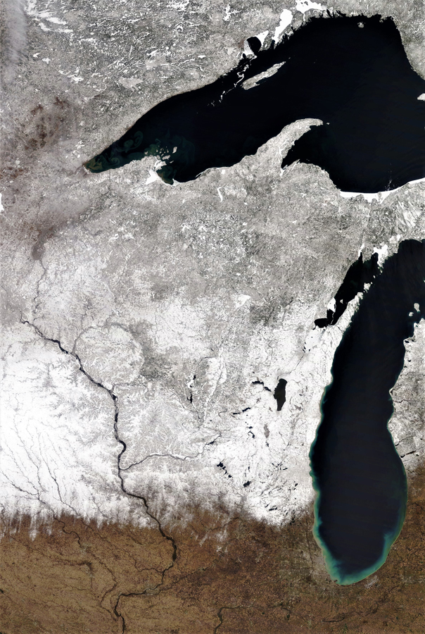 This satellite image taken by NOAA about noon April 19 shows snow cover across almost all of Wisconsin - Photo credit: NOAA