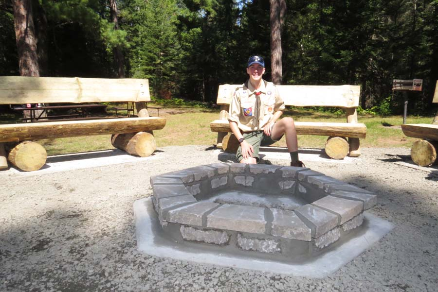 Adam with the fire fing he completed as an Eagle Scout projects. - Photo credit: DNR