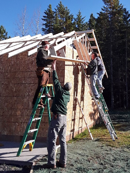 Volunteers working on the new woodshed. - Photo credit: DNR