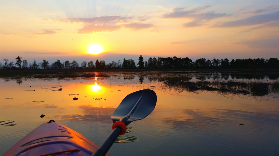 Warmer weather is drawing paddlers and other boaters to lakes and rivers but many remain colder than normal and have higher than normal water levels.  - Photo credit: Sunrise at Bark Bay Slough State Natural Area by Ryan Brady