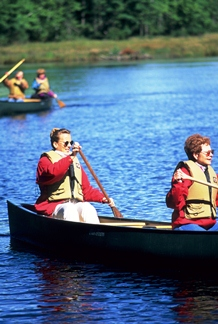 Volunteers canoeing on lake