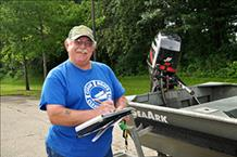 Clean Boats Clean Waters' Gary Harper inspecting a boat