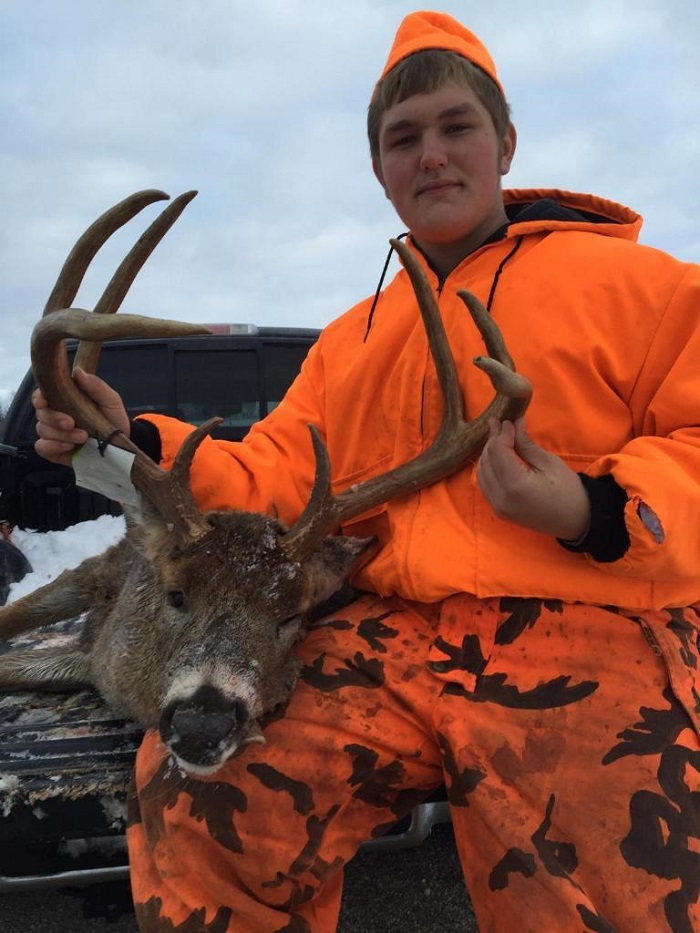 Cody McCollough with his eight point buck, harvested Sunday in Grant County.