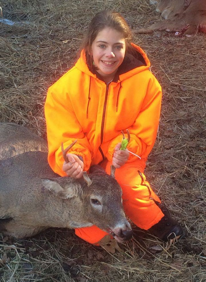 Kayla Schultz with her first buck harvested in Clark County on opening morning.