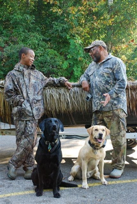 Hunters with their dogs