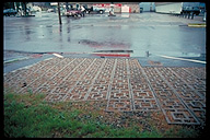Concrete lattice installed in gas station parking lot