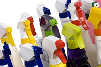 Assorted household cleaner spray bottles