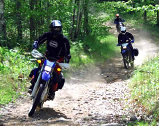 Off-highway motorcycle operators enjoying the trails.