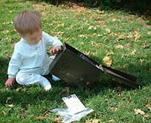 Baby with geocache container