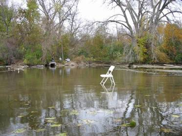 metal chair sitting in a pool of water