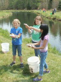 Anglers from St. Anthony's show off their catches at a fishing event organized by Warden Dan Michels of Park Falls.