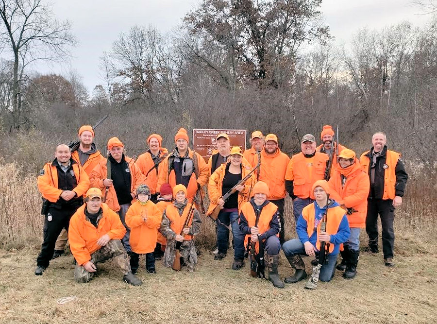 <b>Wardens Jon Scharbarth and Vong Xiong </b>were on hand the final gun-deer day, Sunday, where this group of hunters from five families finished a deer drive on state land in Waupaca County - Photo credit: WDNR Warden Jon Scharbarth