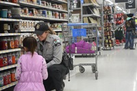 Warden Amanda Kretschmer with her shopping companion. Photo is courtesy of JAKE PRINSEN/Baraboo News Republic.